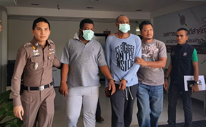 Ositadima Ibeh and Chinedu Calistus Ndubuisi are brought in to face charges of breaking Thailand's computer crime laws.