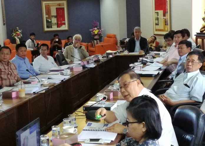 Deputy Mayor Apichart Virapal (back, center) chairs a meeting to hear proposals for designing flood prevention systems in Pattaya. Representatives from the Water Development Co., Ltd., predict an initial budget of 3.411 billion baht would be required to do the job right.