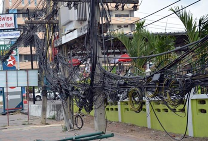 Utility companies, who for years have been ignoring old wiring when replaced by new, causing spaghetti-type messes all over town, now want to raise rates on customers to cover their costs to bury their cables underground in Pattaya. (File photo/Pattaya Mail)