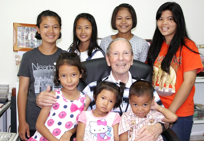 Brother Denis with his children.
