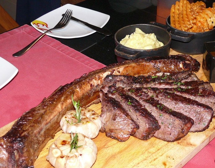 An enormous Tomahawk steak as devoured by Genghis Khan.