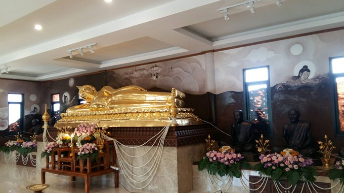 """Nong Plalai's Pasutipawan Temple unveiled seven new Buddha statues, a four-meter-long sleeping Buddha and six life-size """"Luang Poh"""" statues on either side of him, worth more than 2 million baht."""