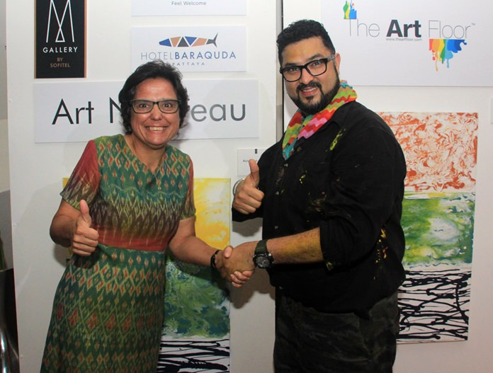 Founder of the Hand to Hand Foundation, Margaret Grainger thanks CEO and founder of The Art Floor, Dashmeet Singh, for the charitable donations.