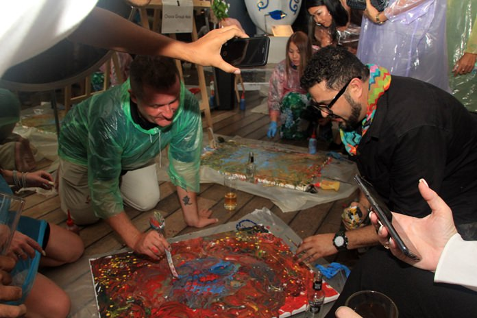 Guests enjoy their hands on experience with water colors.