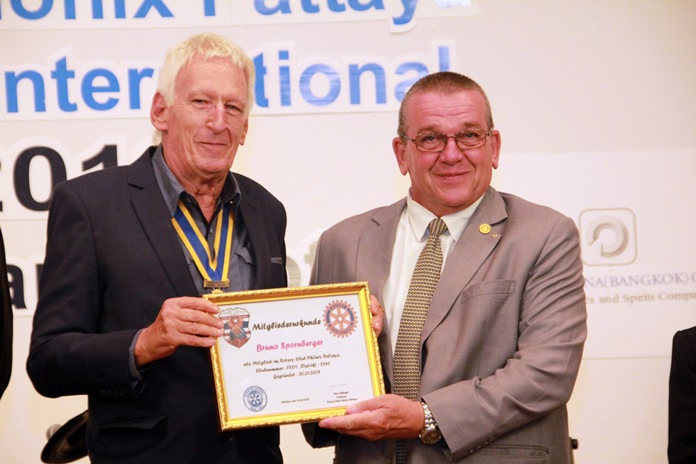 President Peter Schlegel welcomes Bruno Spornberger as a member of the Rotary Club of Phoenix Pattaya.