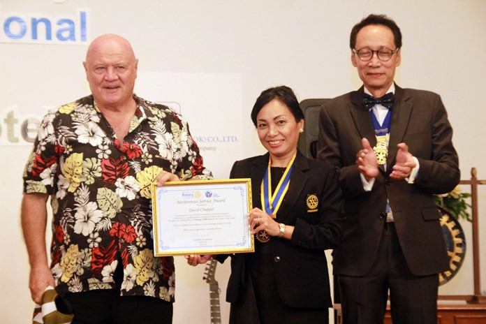 President Gaye and PE Vutikorn Kamolchote present a meritorious Service Award to David Chappell for his staunch support for Rotary throughout the years.