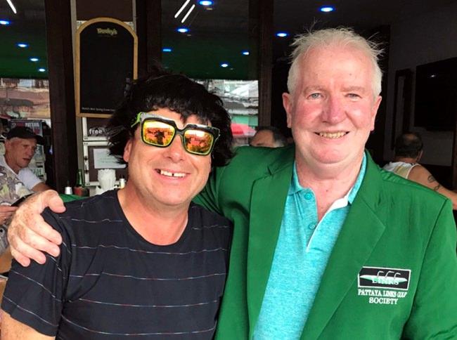Greg Perfrement (right) with wig winner Selwyn Yates.