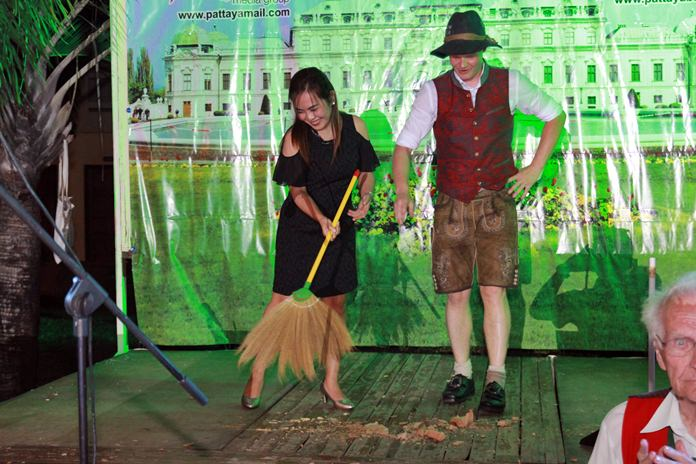 As part of the traditional play-acting, this fair maiden has to clean up the mess caused by the boys' fun and games.