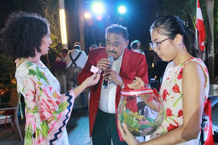 Anselma and Peter, assisted by Khun Nutsara conduct the drawing of raffle prizes.