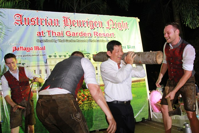 Mayor Anan joins in the 'Holzhacker' song and dance, then carries the fruits of his labour off the stage.