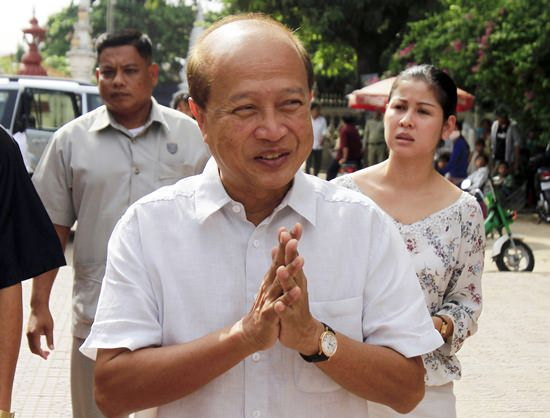 In this Sunday, June 3, 2012, file photo, Cambodian Prince Norodom Ranariddh greets people before casting his ballot in a local elections at the Wat Than temple in Phnom Penh, Cambodia. Ranariddh, 74, has been seriously injured in a road crash that killed his wife and injured at least seven other people early Sunday, June 17, 2018. (AP Photo/Heng Sinith, File)