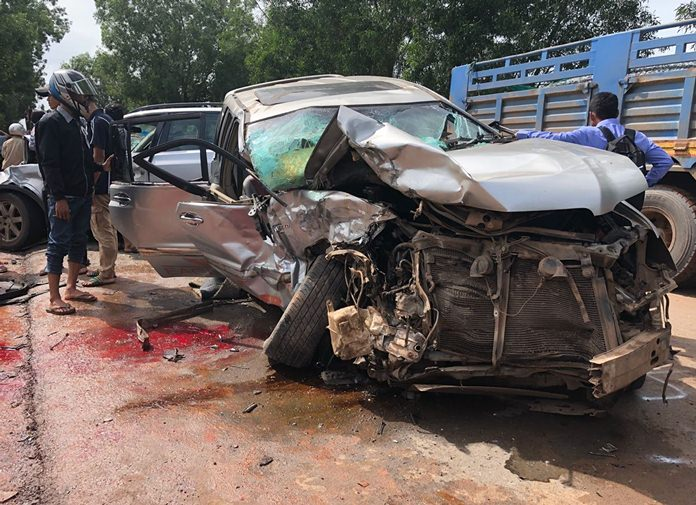 In this photo provided by Cambodia National Police, Cambodia's Prince Norodom Ranariddh's mangled car sits on the side of a road after a collision with another vehicle outside Sihanoukville, Cambodia, Sunday, June 17, 2018. (Cambodia National Police via AP)