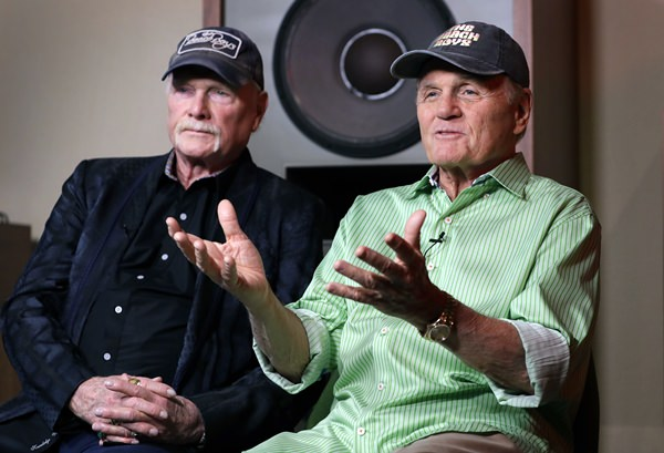Beach Boys musicians Mike Love (left) and Bruce Johnston (right) talk during an interview at Spiritland in London, Wednesday, June 13, 2018. (AP Photo/Kirsty Wigglesworth)