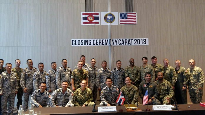 Rear Adm. Thawatchai Muangkam (back row, 7th right), commander of Frigate Squadron 2, and U.S. Capt. Alexis T. Walker (back row, 6th right) officiate at the Cooperation Afloat Readiness and Training closing ceremonies in Pattaya.
