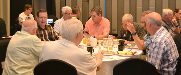 Members and guests enjoy their breakfast buffet and conversation before the start of the Sunday morning PCEC meeting at the Holiday Inn Executive Tower.