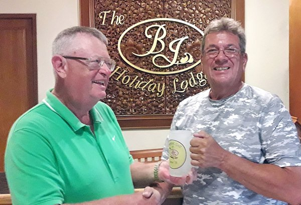 John Pierrel (right) accepts the monthly mug from Dick Warberg.