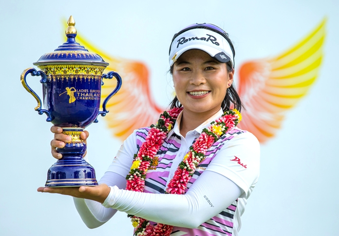 Thailand's Kanyalak Preedasuttijit smiles as she holds the champion's trophy following her victory at the Ladies European Thailand Championship at Phoenix Gold Golf Course in Pattaya, Sunday, June 24.