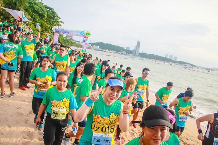 Participants in the 6 kilometer walk run soak up the party atmosphere as they cross the start line.