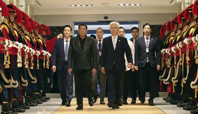 Philippine President Rodrigo Duterte, center left, arrives at Incheon International Airport in Incheon, South Korea, Sunday, June 3. (Kim In-chul/Yonhap via AP)