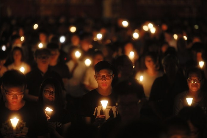 Tens of thousands of people attend an annual candlelight vigil at Hong Kong's Victoria Park, Monday, June 4 as Hong Kongers commemorated victims of the Chinese government's brutal military crackdown nearly three decades ago on protesters in Beijing's Tiananmen Square. (AP Photo/Vincent Yu)