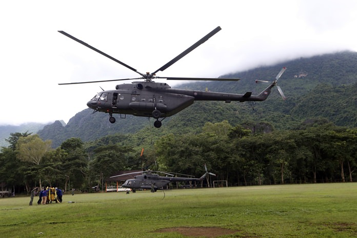 A military transport helicopter prepares to carry drill machine to be used for the search of missing 12 boys and their soccer coach, in Mae Sai, Chiang Rai province, in northern Thailand, Monday, July 2, 2018. Rescue divers are advancing in the main passageway inside the flooded cave in northern Thailand where the boys and their coach have been missing more than a week. (AP Photo/Sakchai Lalit)