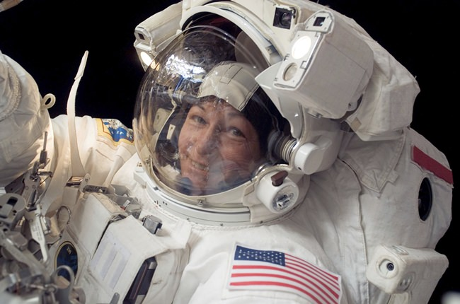 In this Jan. 30, 2008 photo made available by NASA, Expedition 16 commander Peggy Whitson, the first female commander of the International Space Station, participates in a spacewalk. On Friday, June 15, 2018, NASA announced Whitson, who has spent more time off the planet than any other American, has retired. (NASA via  AP)