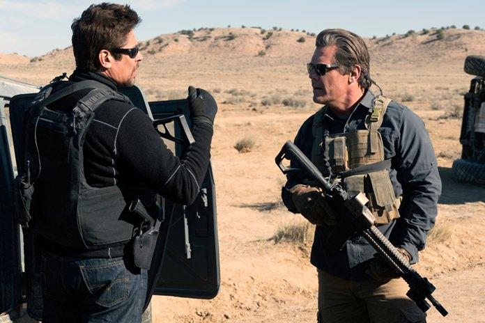"This image shows Benicio Del Toro (left) and Josh Brolin in a scene from ""Sicario: Day of the Soldado."" (Richard Foreman, Jr./Sony Pictures via AP)"