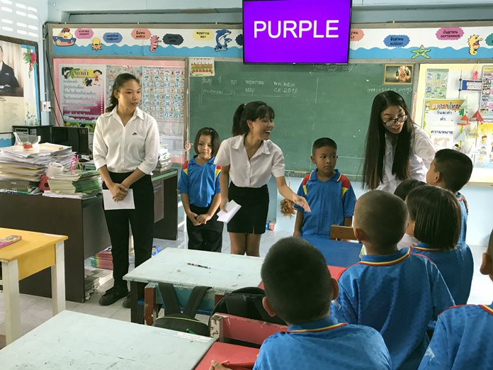 IB students from GIS help teach English at a local Thai school.