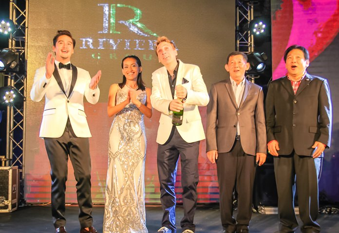 Winston Gale pops open the champagne bottle as Ananda Everingham, Sukanya Gale, Pattaya mayor Anan Charoenchasri and former MP Chanyut Hengtrakul celebrate the launch of Riviera Monaco.