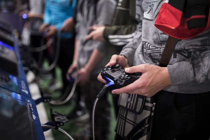A man plays a game at the Paris Games Week in Paris. The World Health Organization says that compulsively playing video games now qualifies as a new mental health condition, in a move that some critics warn may risk stigmatizing its young players. (AP Photo/Kamil Zihnioglu, File)