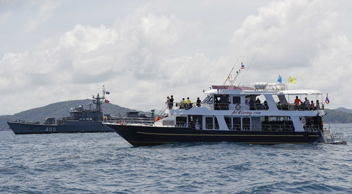 A rescue divers' ship, right, and a Thai Navy ship are seen during a search mission for missing passengers. (AP Photo/Vincent Thian)