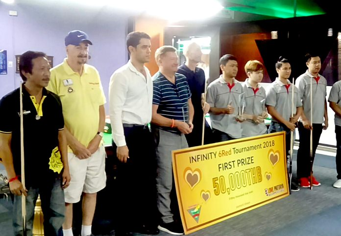 Players, referees and tournament organizers pose at the conclusion of the 6 Reds Pro-Am tournament at the Infinity Snooker Club in Pattaya, Saturday, June 30.