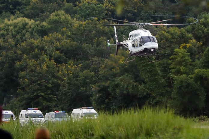 A helicopter believed to be carrying one of the rescued boys departs for the hospital Tuesday, July 10. (AP Photo/Vincent Thian)