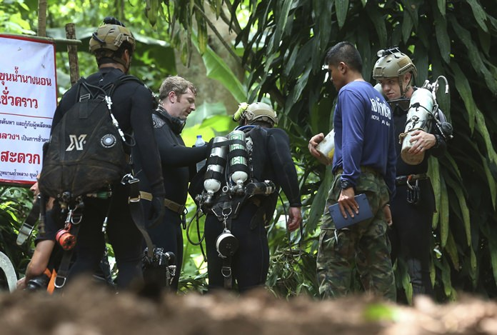 International rescuers prepare to enter the cave on Thursday, July 5. (AP Photo/Sakchai Lalit)
