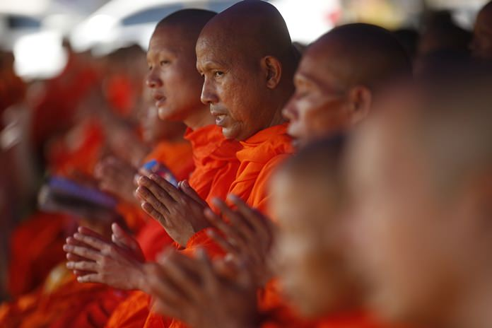 Buddhist monks pray Sunday, July 1, for the 12 boys and their soccer coach. (AP Photo/Sakchai Lalit, File)