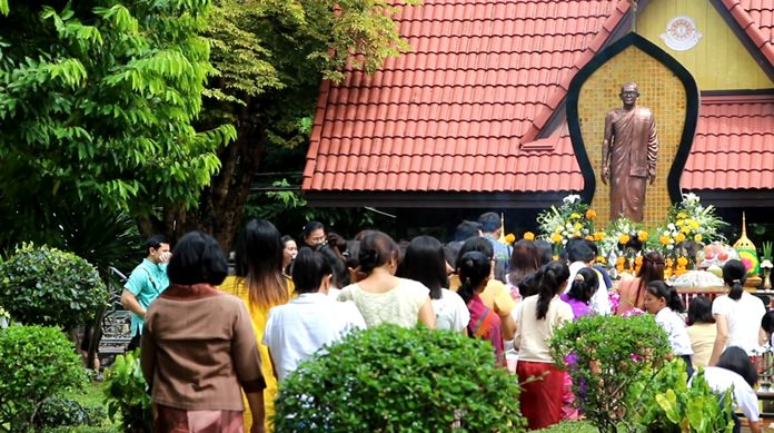 Students light candles and incense to pay homage to school founder Luang Pho Boonmee Akkaboonyo.