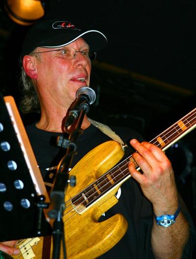 Richard Sinclair is shown performing with Caravan.