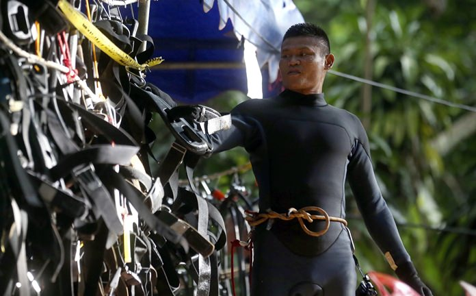 A Thai rescuer hangs his equipment outside a cave where 12 boys and their soccer coach are trapped, in Mae Sai, Chiang Rai province, in northern Thailand, Thursday, July 5, 2018. (AP Photo/Sakchai Lalit)