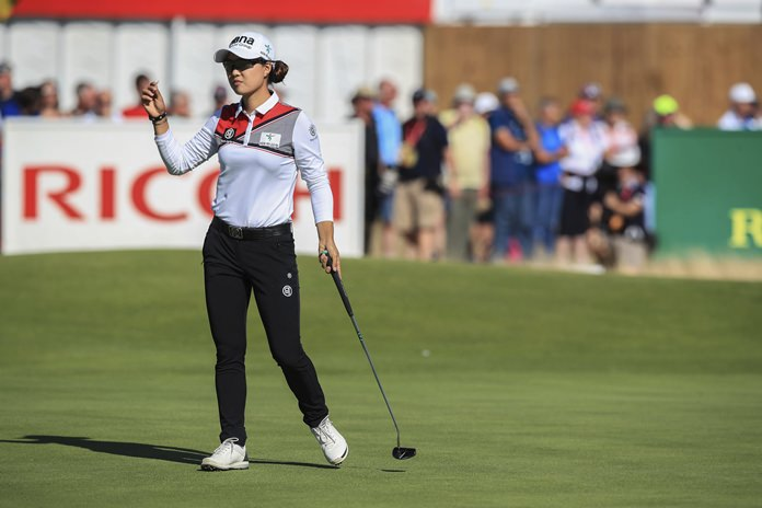 Australia's Minjee Lee gestures on the 18th green during day one of the Women's British Open at Royal Lytham & St Annes Golf Club in Lytham, England, Thursday, Aug. 2. (Peter Byrne/PA via AP)