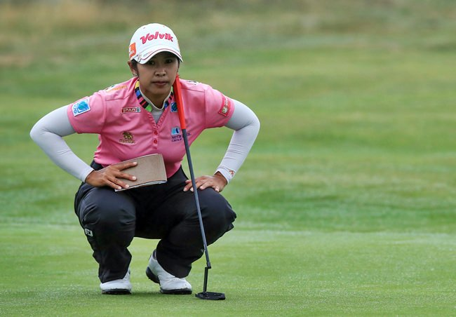 Thailand's Pornanong Phatlum sizes up a putt on the 15th green during day two of the Women's British Open at Royal Lytham & St Annes Golf Club in Lytham, England, Friday, Aug. 3. (Peter Byrne/PA via AP)