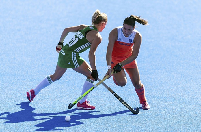 Netherlands' Malou Pheninckx , right, and Ireland's Chloe Watkins vie for the ball during the Women's Hockey World Cup final at The Lee Valley Hockey and Tennis Centre, in London, Sunday Aug. 5. (Paul Harding/PA via AP)
