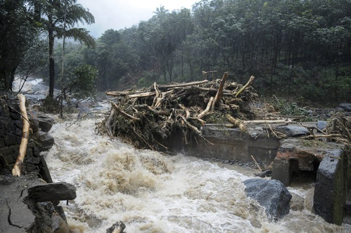 Water gushes out following heavy rain and landslide in Kozhikode, Kerala state, India, Thursday, Aug. 9. (AP Photo)