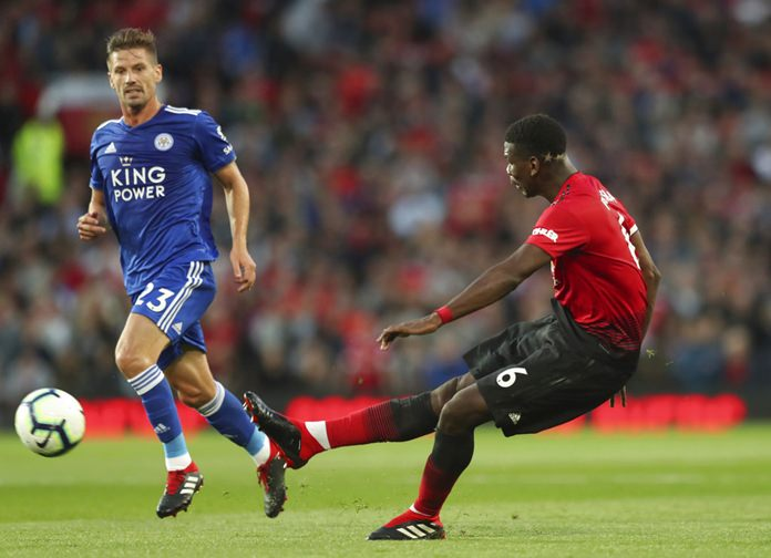 Manchester United's Paul Pogba takes a shot on goal during the English Premier League soccer match between Manchester United and Leicester City at Old Trafford, in Manchester, Friday, Aug. 10. (AP Photo/Jon Super)