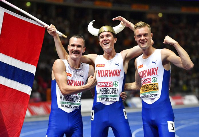 Norway's gold medal winner Jakob Ingebrigtsen is flanked by his brothers Henrik Ingebrigtsen, left, and Filip Ingebrigtsen after the men's 1500-meter final at the European Athletics Championships at the Olympic stadium in Berlin, Germany, Friday, Aug. 10. (AP Photo/Martin Meissner)