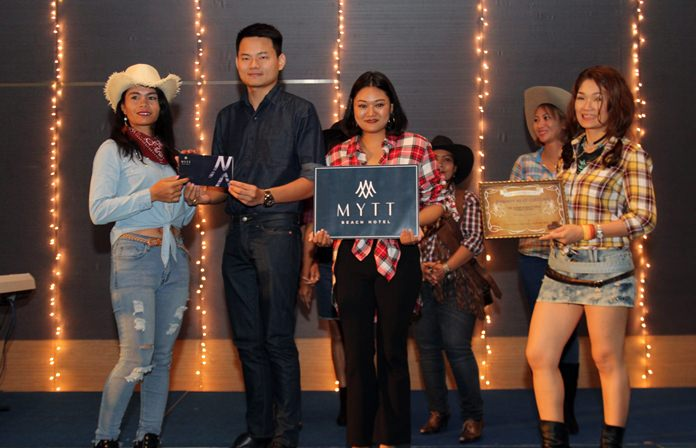 Rachan Buahin, Sales Manager of Mytt Beach resort presents one of the raffle prizes sponsored by the hotel.