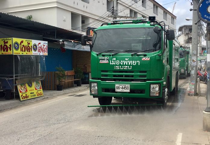 Pattaya workers spray down Soi Khopai to tamp down dust that had been annoying neighbors.