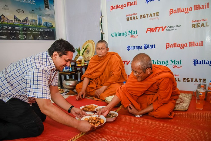 Prince Malhotra Deputy MD makes offerings of food to the monks at the end of the religious ceremonies.