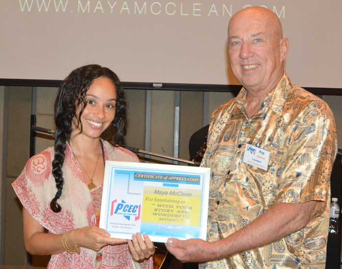 "MC Roy Albiston presents the PCEC's Certificate of Appreciation to Maya McClean thanking her for bringing her music and message about how to ""Live a Higher Truth""."