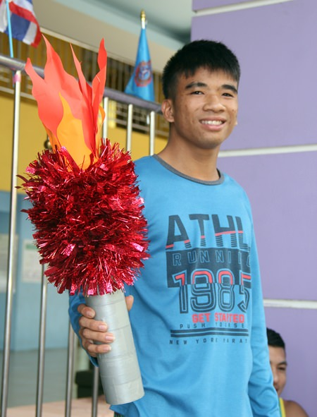 The flame bearer, who will soon represent Thailand at the Special Olympics.