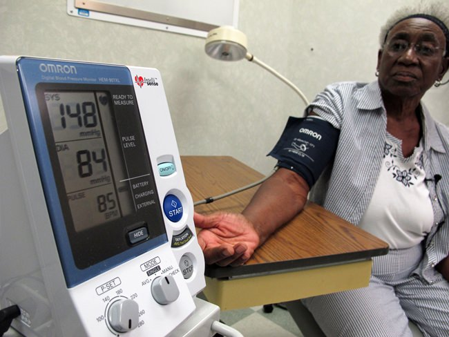 Margaret Graham, 74, has her blood pressure checked while visiting the Wake Forest Baptist Medical Center in Winston-Salem, N.C., on Friday, July 13, 2018. She had participated in a multi-year study, published on Wednesday, July 25, 2018, investigating a connection between high blood pressure and the risk of mental decline. (AP Photo/Allen G. Breed)